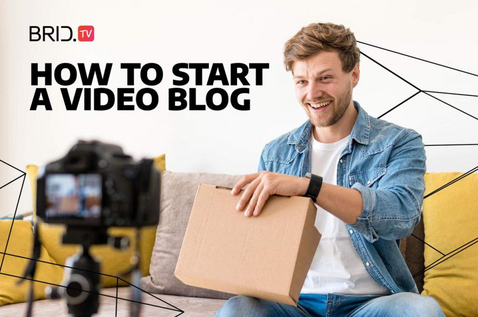 "man sitting in front of a camera with a cardboardbox and ""how to start a video blog"" text on image"