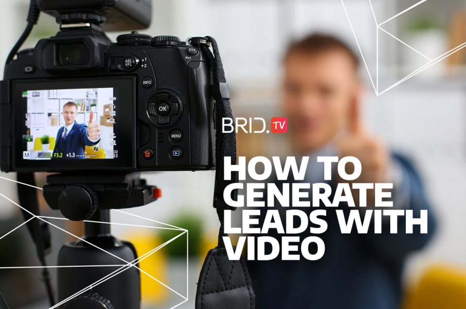 man in business suit in front of a camera for an article about video lead generation